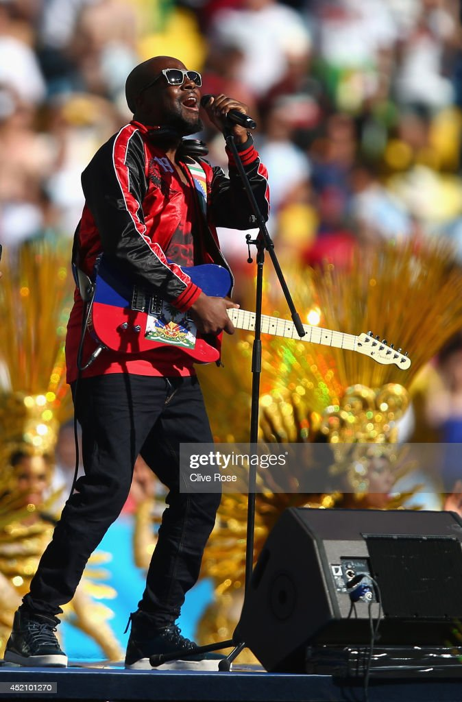 Musician <a gi-track='captionPersonalityLinkClicked' href=/galleries/search?phrase=Wyclef+Jean&family=editorial&specificpeople=171115 ng-click='$event.stopPropagation()'>Wyclef Jean</a> performs during the closing ceremony prior to the 2014 FIFA World Cup Brazil Final match between Germany and Argentina at Maracana on July 13, 2014 in Rio de Janeiro, Brazil.