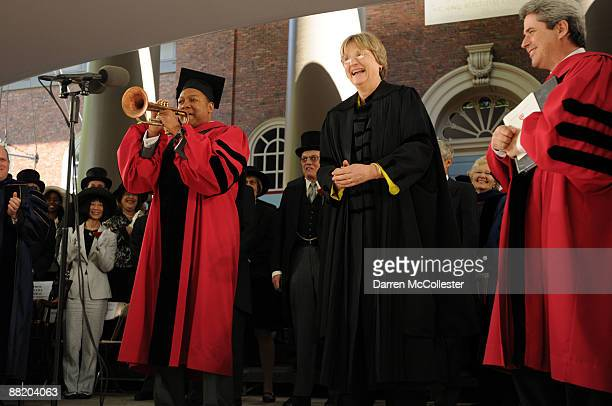 Musician Wynton Marsalis plays America The Beautiful alongside Harvard University President Drew Gilpin Faust following commencement ceremonies at...