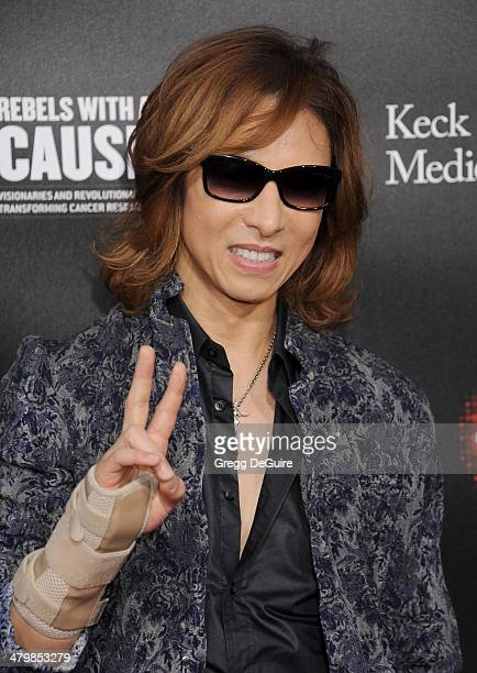 Musician Yoshiki Hayashi arrives at the 2nd Annual Rebel With A Cause Gala at Paramount Studios on March 20 2014 in Hollywood California