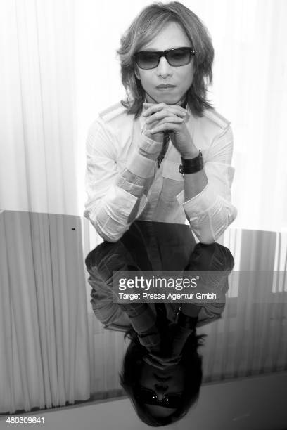 Musician Yoshiki poses during a photocall at Grand Hyatt Hotel on March 24 2014 in Berlin Germany