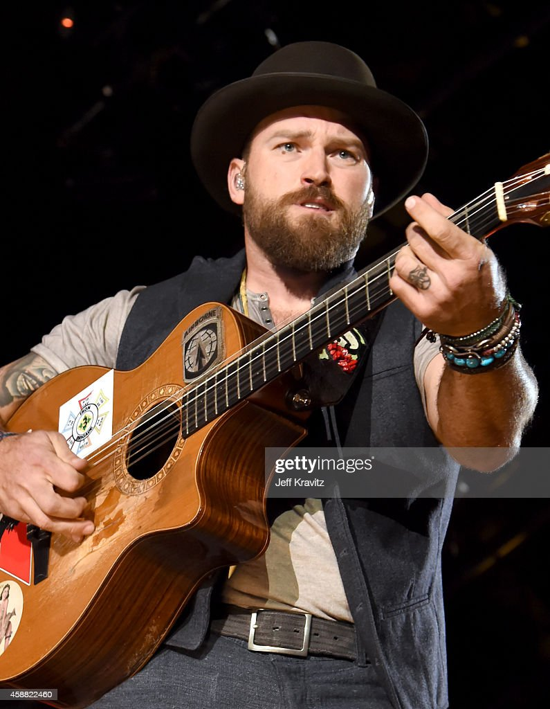 Musician <a gi-track='captionPersonalityLinkClicked' href=/galleries/search?phrase=Zac+Brown+-+Singer&family=editorial&specificpeople=6705520 ng-click='$event.stopPropagation()'>Zac Brown</a> of <a gi-track='captionPersonalityLinkClicked' href=/galleries/search?phrase=Zac+Brown+Band&family=editorial&specificpeople=5796430 ng-click='$event.stopPropagation()'><a gi-track='captionPersonalityLinkClicked' href=/galleries/search?phrase=Zac+Brown+-+Singer&family=editorial&specificpeople=6705520 ng-click='$event.stopPropagation()'>Zac Brown</a> Band</a> performs onstage during 'The Concert For Valor' at The National Mall on November 11, 2014 in Washington, DC.