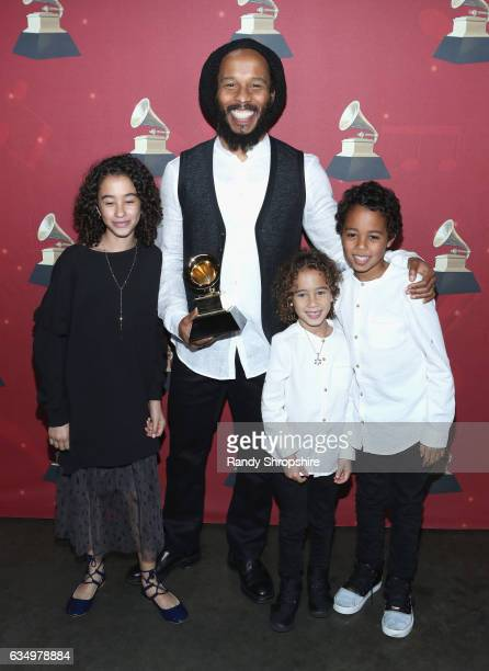 Musician Ziggy Marley poses with the award for Best Reggae Album backstage at the Premiere Ceremony during the 59th GRAMMY Awards at Microsoft...