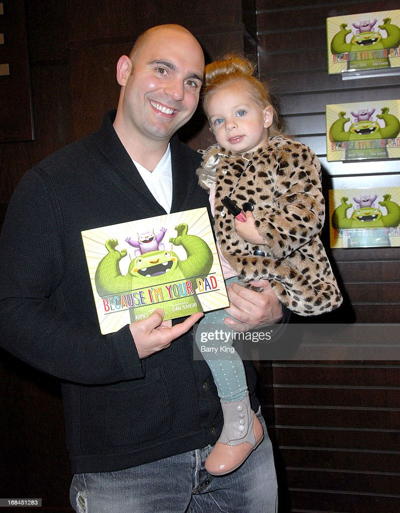 Musician/actor <a gi-track='captionPersonalityLinkClicked' href=/galleries/search?phrase=Ahmet+Zappa&family=editorial&specificpeople=804111 ng-click='$event.stopPropagation()'>Ahmet Zappa</a> signs copies of his new book 'Because I'm Your Dad' with daughter Halo Viioletta Zappa on May 9, 2013 at Barnes & Noble at The Grove in Los Angeles, California.