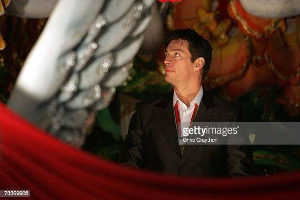 Musician/actor Harry Connick Jr looks to throw a pair of beads during the Orpheus parade along St Charles Avenue February 19 2006 in New Orleans...