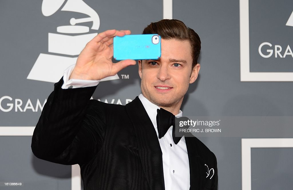 Musician/actor Justin Timberlake arrives on the red carpet at the Staples Center for the 55th Grammy Awards in Los Angeles, California, February 10, 2013. AFP PHOTO Frederic J. BROWN