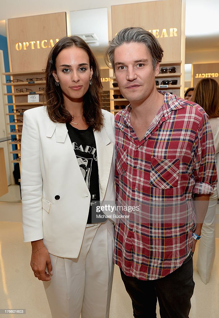 Musician/actress <a gi-track='captionPersonalityLinkClicked' href=/galleries/search?phrase=Sophie+Auster&family=editorial&specificpeople=2098020 ng-click='$event.stopPropagation()'>Sophie Auster</a> (L) and artist Nate Lowman attend Warby Parker's store opening in The Standard, Hollywood on August 15, 2013 in Los Angeles, California.