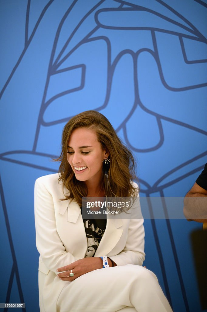 Musician/actress <a gi-track='captionPersonalityLinkClicked' href=/galleries/search?phrase=Sophie+Auster&family=editorial&specificpeople=2098020 ng-click='$event.stopPropagation()'>Sophie Auster</a> performs at Warby Parker's store opening in The Standard, Hollywood on August 15, 2013 in Los Angeles, California.