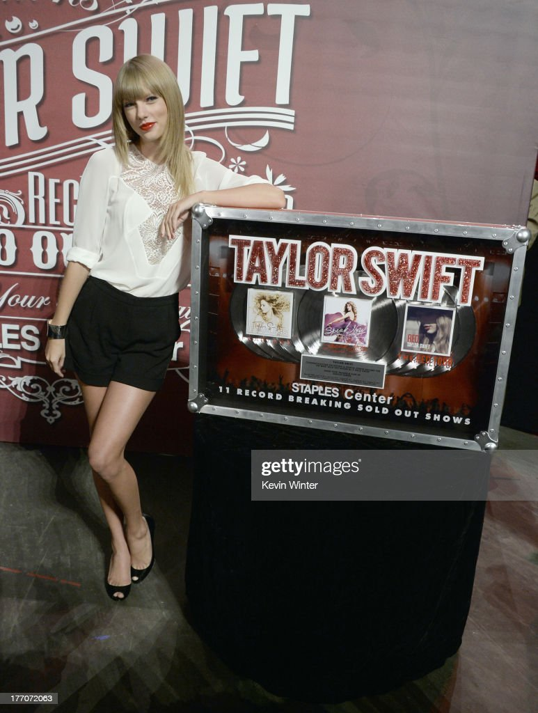 Musician/actress <a gi-track='captionPersonalityLinkClicked' href=/galleries/search?phrase=Taylor+Swift&family=editorial&specificpeople=619504 ng-click='$event.stopPropagation()'>Taylor Swift</a>, wearing Elie Saab top and shorts and Jimmy Choo shoes, attends a press event for breaking The Staple Center's record of most sold-out shows for a solo artist held at the Staples Center on August 20, 2013 in Los Angeles, California. She has surpassed Madonna and Justin Timberlake for seven sellouts and Britney Spears at eight sellout shows.