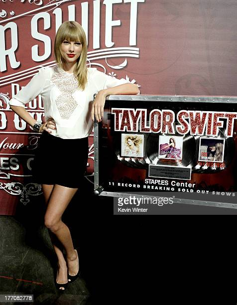 Musician/actress Taylor Swift wearing Elie Saab top and shorts attends a press event for breaking The Staples Center's record of most soldout shows...