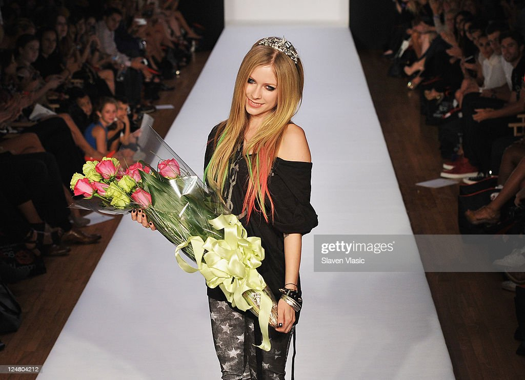 Musician/designer <a gi-track='captionPersonalityLinkClicked' href=/galleries/search?phrase=Avril+Lavigne&family=editorial&specificpeople=171190 ng-click='$event.stopPropagation()'>Avril Lavigne</a> walks the runway at the Abbey Dawn by <a gi-track='captionPersonalityLinkClicked' href=/galleries/search?phrase=Avril+Lavigne&family=editorial&specificpeople=171190 ng-click='$event.stopPropagation()'>Avril Lavigne</a> Spring 2012 fashion show during Style360 on September 12, 2011 in New York City.