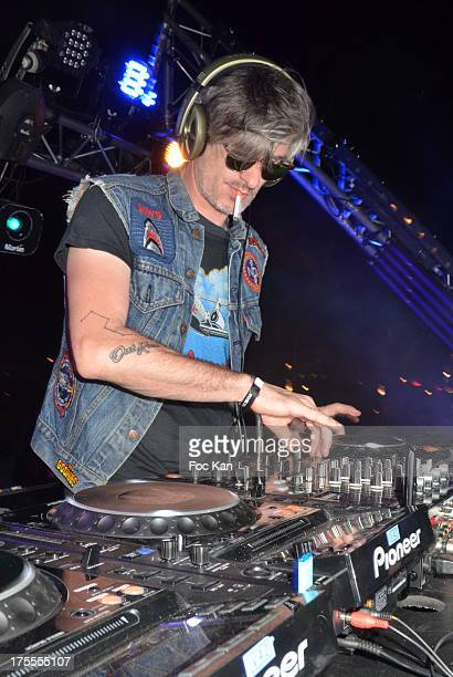 Musician/DJ Kavinsky performs during the Axe Boat 2013 Launch Party at Cannes Harbourg on August 3 2013 in Saint Tropez France