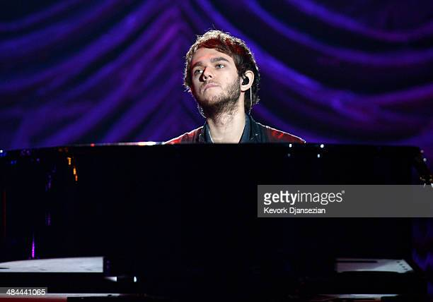 Musician/DJ Zedd performs onstage during rehearsals for the 2014 MTV Movie Awards at Nokia Theatre LA Live on April 12 2014 in Los Angeles California