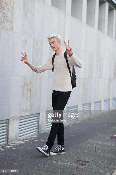 Musician/model Lucky Blue Smith exits the Salvatore Ferragamo show in Converse sneakers on June 21 2015 in Milan Italy