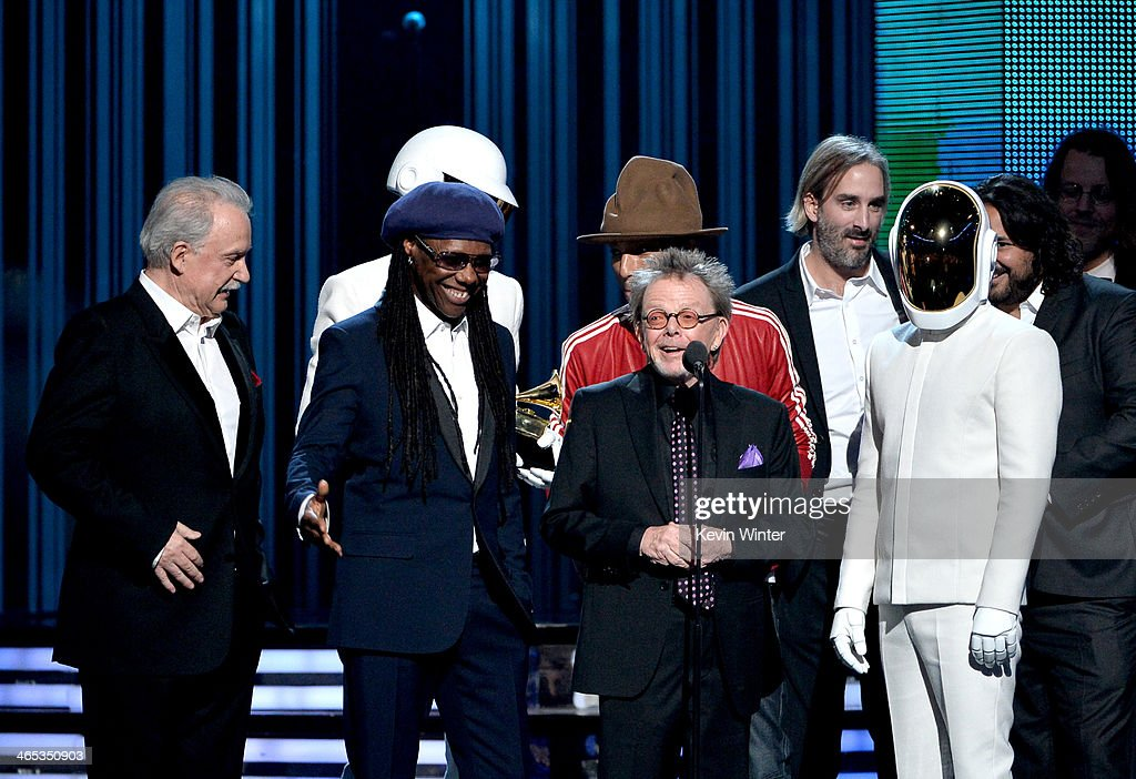 Musician/producer <a gi-track='captionPersonalityLinkClicked' href=/galleries/search?phrase=Nile+Rodgers&family=editorial&specificpeople=217582 ng-click='$event.stopPropagation()'>Nile Rodgers</a>, Composer Paul Williams, Singer/songwriter <a gi-track='captionPersonalityLinkClicked' href=/galleries/search?phrase=Pharrell+Williams&family=editorial&specificpeople=161396 ng-click='$event.stopPropagation()'>Pharrell Williams</a> accept the Album of the Year award on behalf of <a gi-track='captionPersonalityLinkClicked' href=/galleries/search?phrase=Daft+Punk&family=editorial&specificpeople=660593 ng-click='$event.stopPropagation()'>Daft Punk</a> onstage during the 56th GRAMMY Awards at Staples Center on January 26, 2014 in Los Angeles, California.