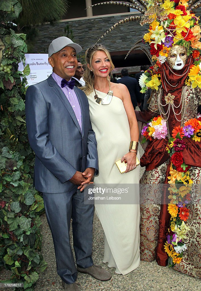 Musician/Producer <a gi-track='captionPersonalityLinkClicked' href=/galleries/search?phrase=Russell+Simmons&family=editorial&specificpeople=202479 ng-click='$event.stopPropagation()'>Russell Simmons</a> (L) and Chrysalis Co-Chair <a gi-track='captionPersonalityLinkClicked' href=/galleries/search?phrase=Rebecca+Gayheart&family=editorial&specificpeople=204784 ng-click='$event.stopPropagation()'>Rebecca Gayheart</a>-Dane arrive at the 12th Annual Chrysalis Butterfly Ball on June 8, 2013 in Los Angeles, California.