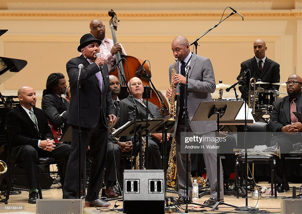 Musicians Aaron Neville and Branford Marsalis perform with The New Orleans Jazz Orchestra at Carnegie Hall on October 8, 2012 in New York, New York.