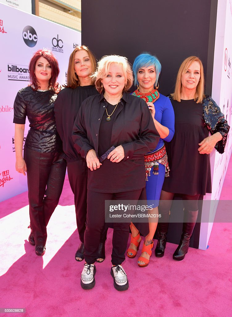 Musicians Abby Travis Belinda Carlisle Gina Schock Jane Wiedlin and Charlotte Caffey of The GoGo's attend the 2016 Billboard Music Awards at TMobile...