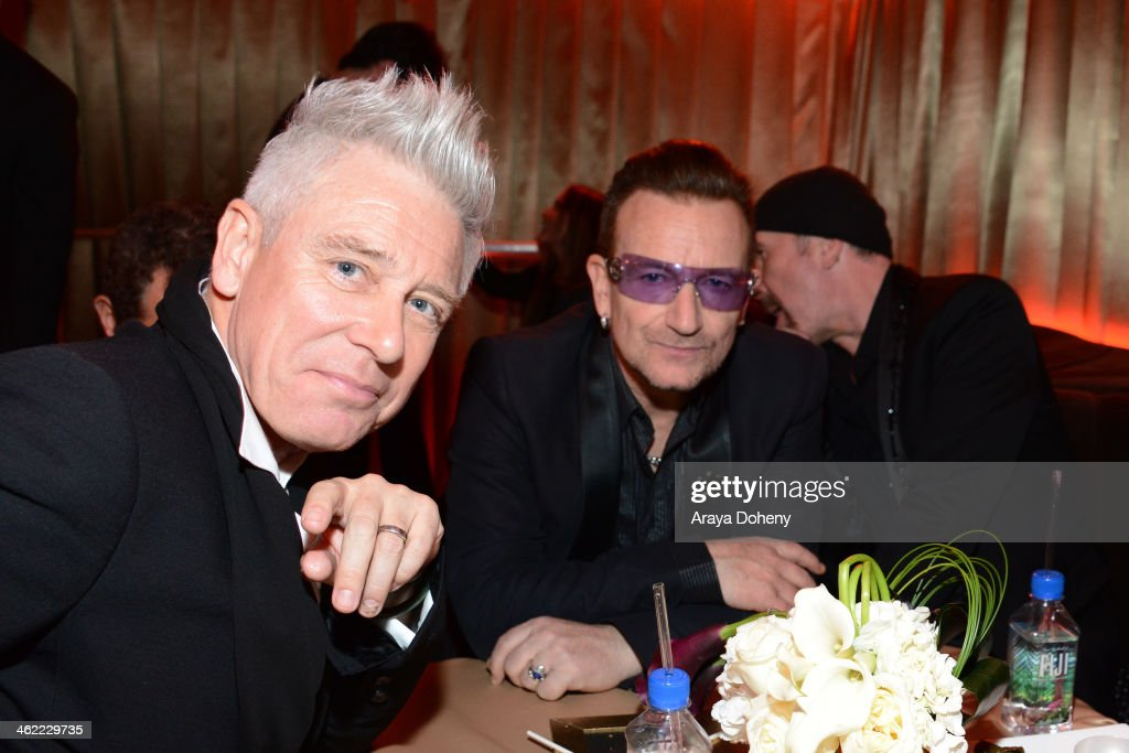 Musicians Adam Clayton and Bono of U2 attend The Weinstein Company Netflix's 2014 Golden Globes After Party presented by Bombardier FIJI Water Lexus...