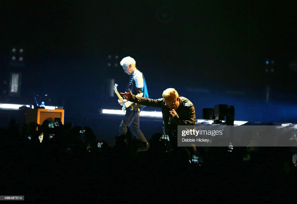 Musicians Adam Clayton and Bono of U2 perform onstage at 3 Arena on November 23 2015 in Dublin Ireland