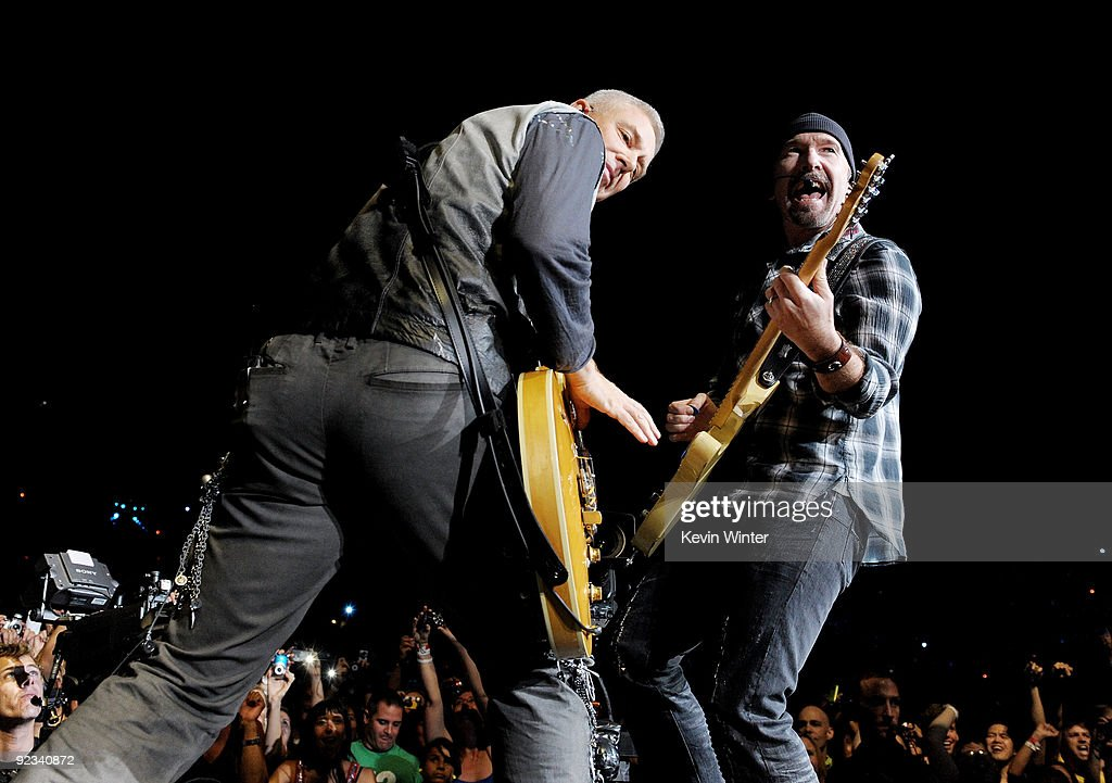 Musicians Adam Clayton and The Edge of U2 perform onstage during their '360 Degrees Tour' at the Rose Bowl on October 25 2009 in Pasadena California