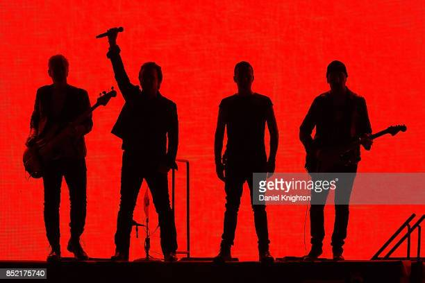 Musicians Adam Clayton Bono Larry Mullen Jr and The Edge perform on stage on the final night of U2 The Joshua Tree Tour 2017 at SDCCU Stadium on...