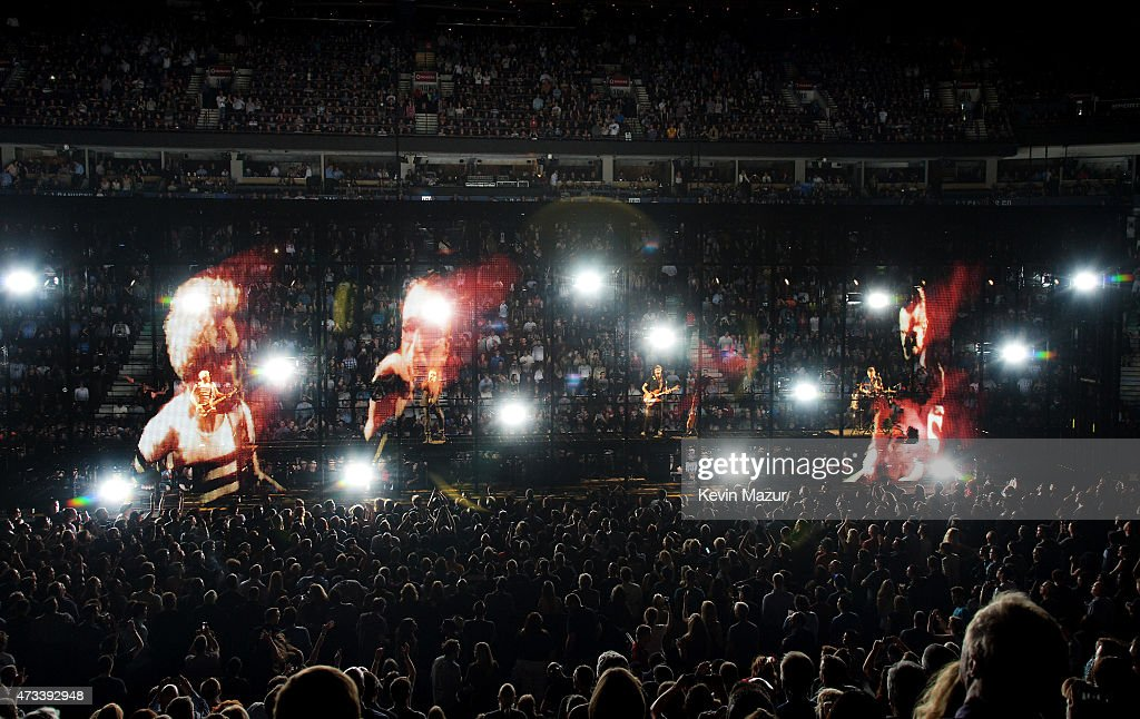 Musicians Adam Clayton BonoThe Edge and Larry Mullen Jr of U2 perform onstage during the U2 iNNOCENCE eXPERIENCE tour opener in Vancouver at Rogers...