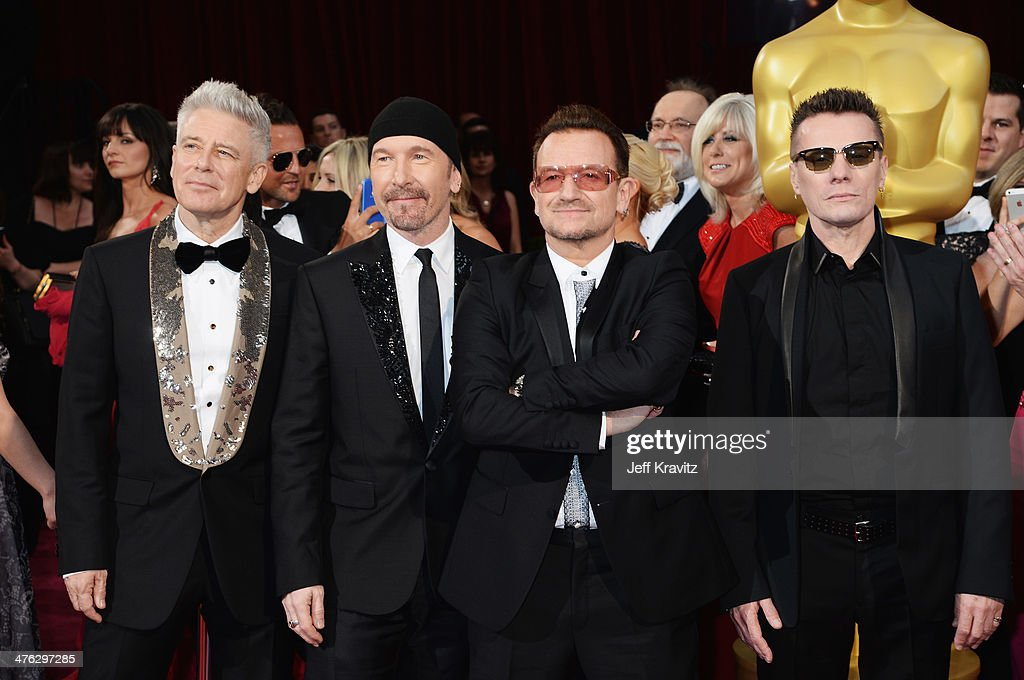 Musicians Adam Clayton, The Edge, <a gi-track='captionPersonalityLinkClicked' href=/galleries/search?phrase=Bono+-+Singer&family=editorial&specificpeople=167279 ng-click='$event.stopPropagation()'>Bono</a> and <a gi-track='captionPersonalityLinkClicked' href=/galleries/search?phrase=Larry+Mullen+Jr.&family=editorial&specificpeople=211542 ng-click='$event.stopPropagation()'>Larry Mullen Jr.</a> attend the Oscars held at Hollywood & Highland Center on March 2, 2014 in Hollywood, California.