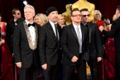 Musicians Adam Clayton The Edge Bono and Larry Mullen Jr of U2 attend the Oscars held at Hollywood Highland Center on March 2 2014 in Hollywood...