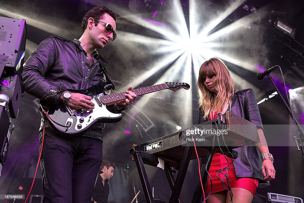 Musicians Adam Miller and Ruth Radelet of Chromatics perform on stage during Day 2 of Fun Fun Fun Fest at Auditorium Shores on November 9, 2013 in Austin, Texas.