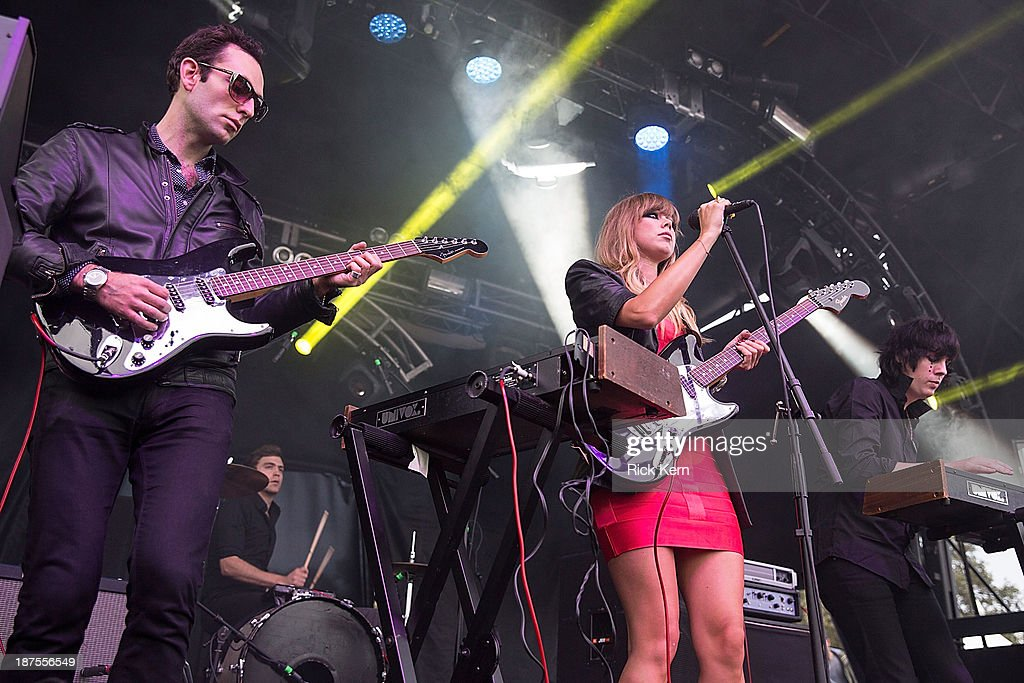 Musicians Adam Miller, Nat Walker, Ruth Radelet, and Johnny Jewel of Chromatics perform on stage during Day 2 of Fun Fun Fun Fest at Auditorium Shores on November 9, 2013 in Austin, Texas.