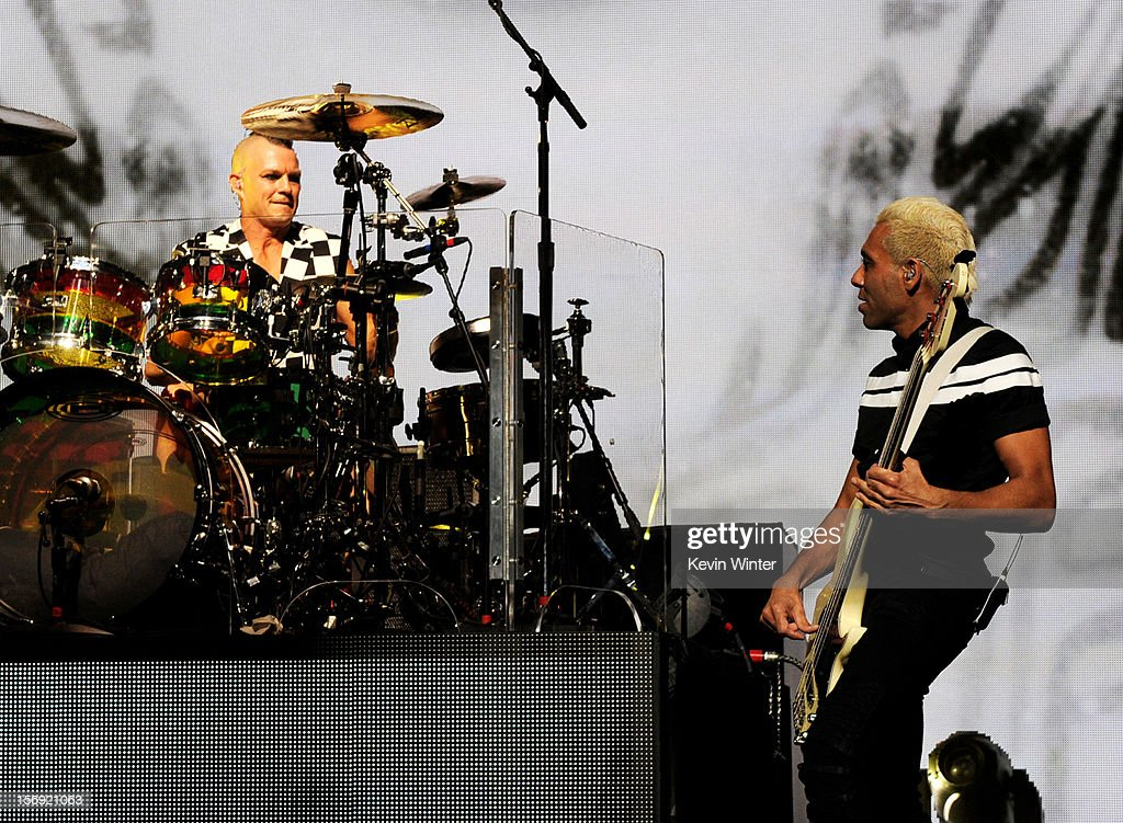 Musicians Adrian Young (L) and Tony Kanal of No Doubt perform at Gibson Amphitheatre on November 24, 2012 in Universal City, California.