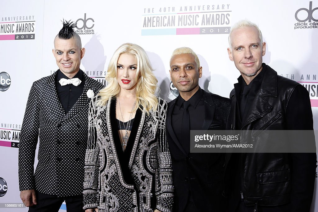 Musicians Adrian Young, Gwen Stefani, Tony Kanal and of No Doubt attend the 40th American Music Awards held at Nokia Theatre L.A. Live on November 18, 2012 in Los Angeles, California.