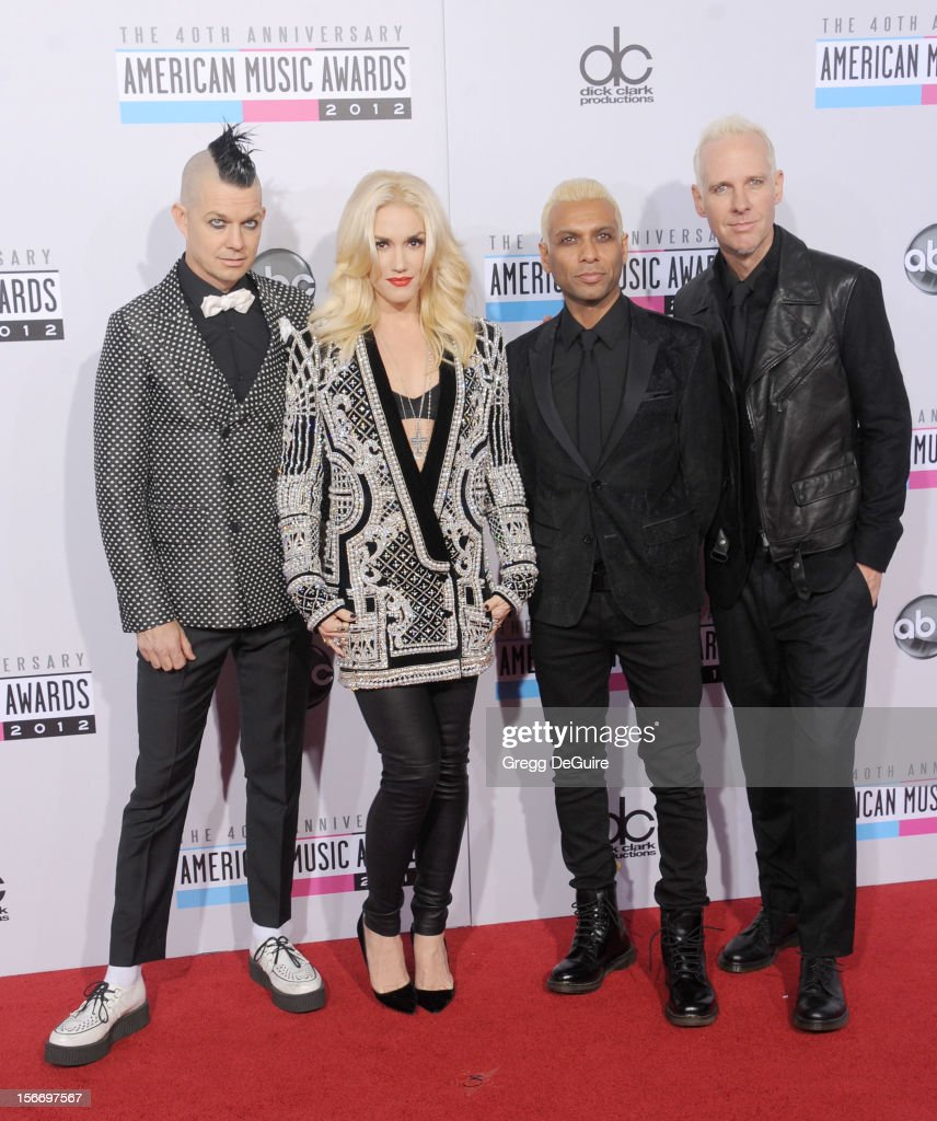 Musicians Adrian Young, Gwen Stefani, Tony Kanal and Tom Dumont of No Doubt arrive at the 40th Anniversary American Music Awards at Nokia Theatre L.A. Live on November 18, 2012 in Los Angeles, California.