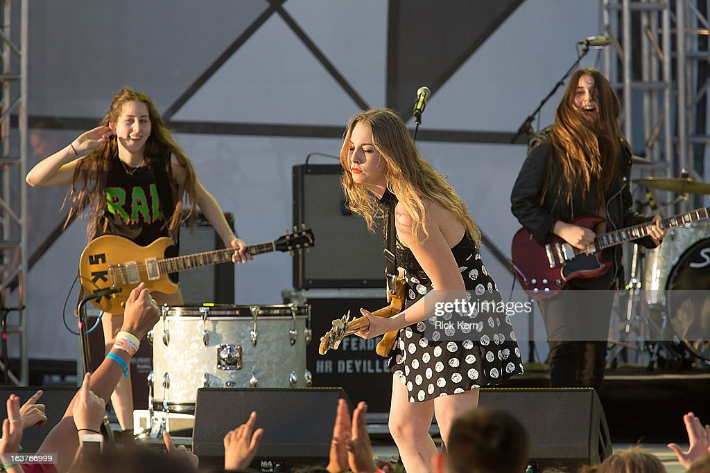Musicians <a gi-track='captionPersonalityLinkClicked' href=/galleries/search?phrase=Alana+Haim&family=editorial&specificpeople=9431818 ng-click='$event.stopPropagation()'>Alana Haim</a>, <a gi-track='captionPersonalityLinkClicked' href=/galleries/search?phrase=Este+Haim&family=editorial&specificpeople=2499486 ng-click='$event.stopPropagation()'>Este Haim</a>, and <a gi-track='captionPersonalityLinkClicked' href=/galleries/search?phrase=Danielle+Haim&family=editorial&specificpeople=2499485 ng-click='$event.stopPropagation()'>Danielle Haim</a> of Haim perform on stage during the 9th Annual mtvU Woodie Awards on March 14, 2013 in Austin, Texas.