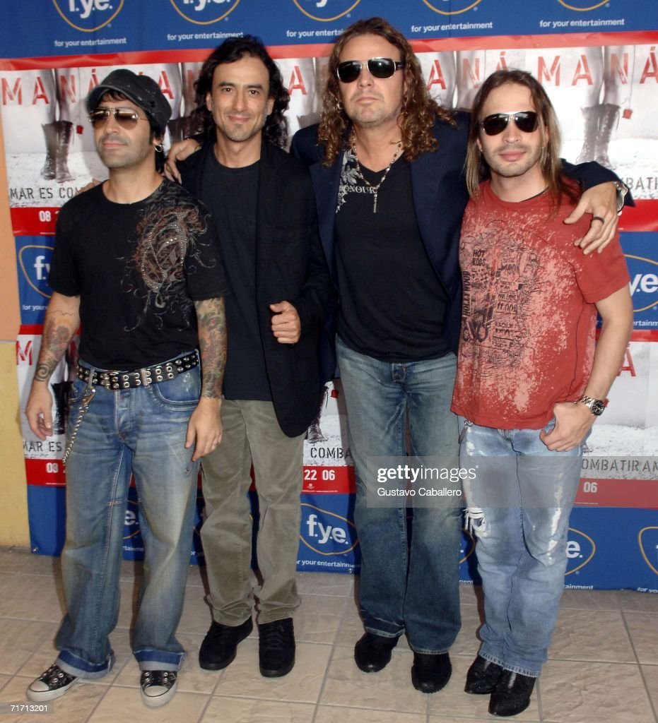 Musicians Alex Gonzalez, Juan Calleros, Fher Olvera and Sergio Vallin of Mana pose for a photo before signing copies of their new CD 'Amar Es Combatir' at F.Y.E. at the Dolphin Mall on August 24, 2006 in Miami, Florida.