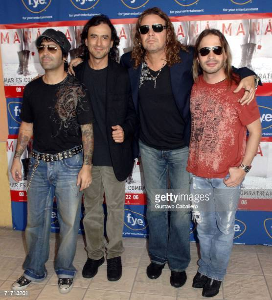 Musicians Alex Gonzalez Juan Calleros Fher Olvera and Sergio Vallin of Mana pose for a photo before signing copies of their new CD 'Amar Es Combatir'...