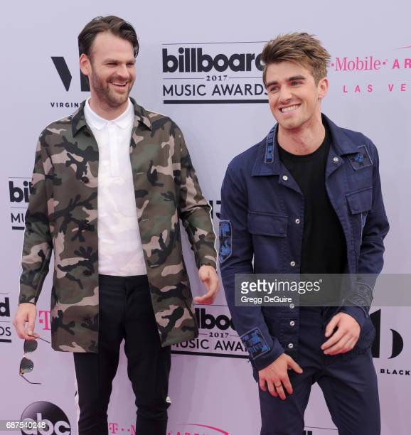 Musicians Alex Pall and Andrew Taggart of The Chainsmokers arrive at the 2017 Billboard Music Awards at TMobile Arena on May 21 2017 in Las Vegas...