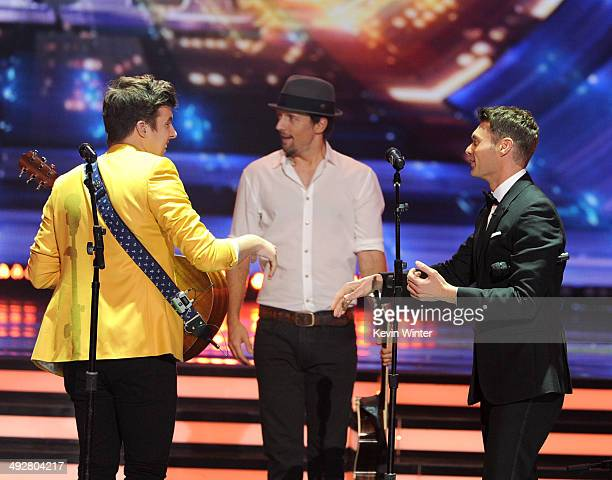 Musicians Alex Preston Jason Mraz and host Ryan Seacrest onstage during Fox's 'American Idol' XIII Finale at Nokia Theatre LA Live on May 21 2014 in...