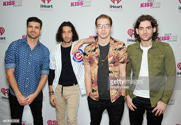 Musicians Alex Tanas Nasri Mark Pellizzer and Ben Spivak of Magic attend 1035 KISS FM's Jingle Ball 2014 at Allstate Arena on December 18 2014 in...
