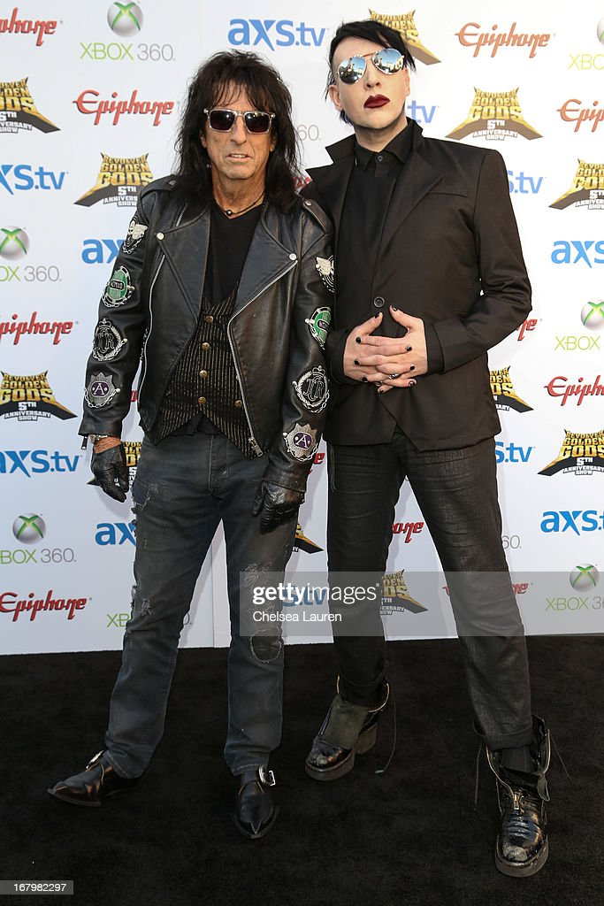 Musicians <a gi-track='captionPersonalityLinkClicked' href=/galleries/search?phrase=Alice+Cooper&family=editorial&specificpeople=202989 ng-click='$event.stopPropagation()'>Alice Cooper</a> (L) and <a gi-track='captionPersonalityLinkClicked' href=/galleries/search?phrase=Marilyn+Manson&family=editorial&specificpeople=208980 ng-click='$event.stopPropagation()'>Marilyn Manson</a> arrive at the 5th Annual Revolver Golden Gods awards show at Club Nokia on May 2, 2013 in Los Angeles, California.