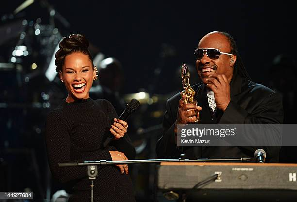 Musicians Alicia Keys and Stevie Wonder perform onstage at the 2012 Billboard Music Awards at the MGM Grand Garden Arena on May 20 2012 in Las Vegas...