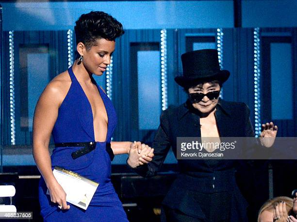 Musicians Alicia Keys and Yoko Ono speak onstage during the 56th GRAMMY Awards at Staples Center on January 26 2014 in Los Angeles California