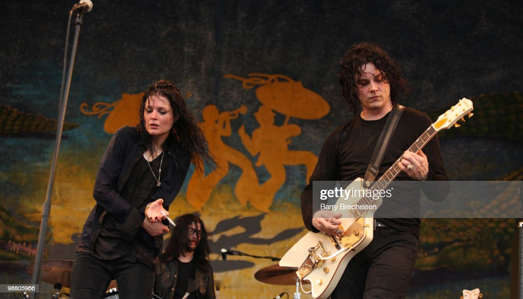Musicians <a gi-track='captionPersonalityLinkClicked' href=/galleries/search?phrase=Alison+Mosshart&family=editorial&specificpeople=226602 ng-click='$event.stopPropagation()'>Alison Mosshart</a>, <a gi-track='captionPersonalityLinkClicked' href=/galleries/search?phrase=Jack+Lawrence&family=editorial&specificpeople=4202985 ng-click='$event.stopPropagation()'>Jack Lawrence</a> and <a gi-track='captionPersonalityLinkClicked' href=/galleries/search?phrase=Jack+White+-+American+Musician+and+Producer&family=editorial&specificpeople=213141 ng-click='$event.stopPropagation()'>Jack White</a> of the Dead Weather perform during day 7 of the 41st annual New Orleans Jazz & Heritage Festival at the Fair Grounds Race Course on May 2, 2010 in New Orleans, Louisiana.