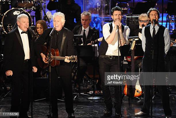 Musicians Allan Clarke and Graham Nash of the Hollies perform onstage with Adam Levine and Jesse Carmichael of Maroon 5 at the 25th Annual Rock and...