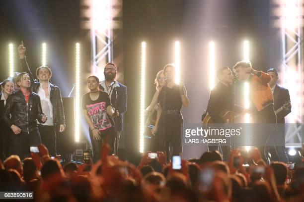 Musicians and Bryan Adams perform Adams' song 'Summer of 69' during the JUNO awards show finale at the Canadian Tire Centre in Ottawa Canada April 2...