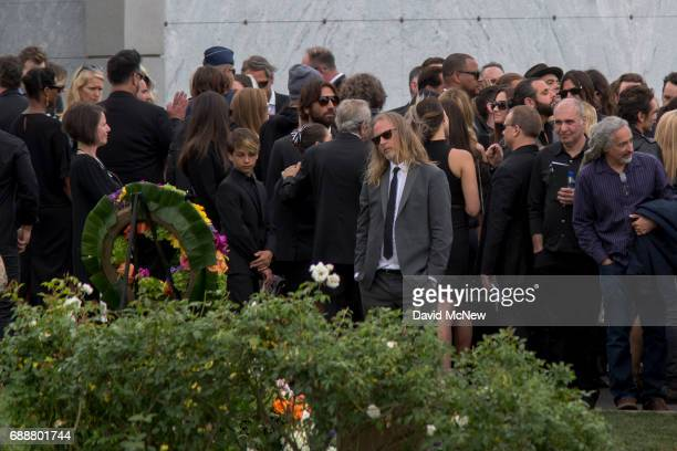 Musicians and loved ones stand graveside at funeral services for Soundgarden frontman Chris Cornell at Hollywood Forever Cemetery on May 26 2017 in...