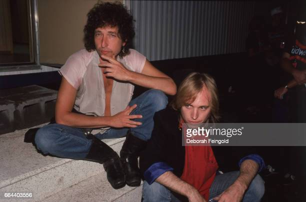 Musicians and songwriters Bob Dylan and Tom Petty pose at Farm Aid on September 22 1985 in Champaign Illinois