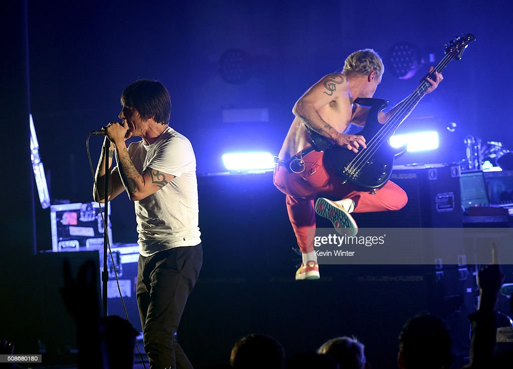 Musicians Anthony Kiedis and Flea of the Red Hot Chili Peppers perform onstage during the 'Feel The Bern' fundraiser concert to benefit presidential candidate Bernie Sanders at the Ace Theater Downtown LA on February 5, 2016 in Los Angeles, California.