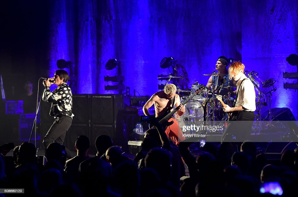Musicians Anthony Kiedis, Flea, Chad Smith and Josh Klinghoffer of the Red Hot Chili Peppers perform onstage during the 'Feel The Bern' fundraiser concert to benefit presidential candidate Bernie Sanders at the Ace Theater Downtown LA on February 5, 2016 in Los Angeles, California.