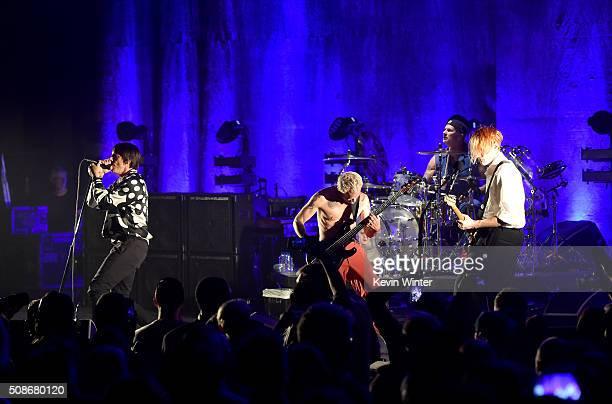 Musicians Anthony Kiedis Flea Chad Smith and Josh Klinghoffer of the Red Hot Chili Peppers perform onstage during the 'Feel The Bern' fundraiser...